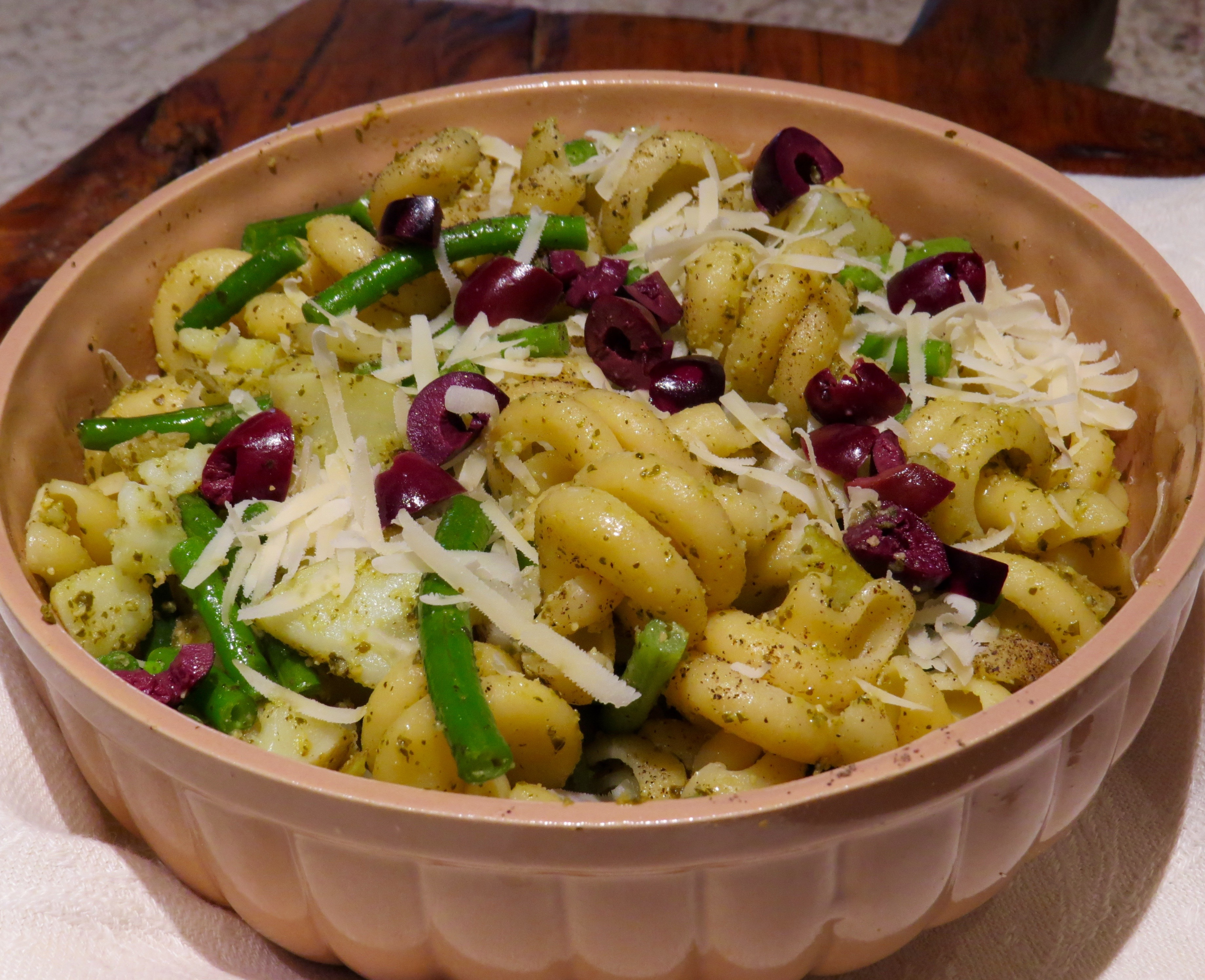 Pasta with new potatoes, green beans, and pesto, served steaming hot or room temperature.