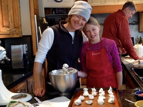 Emma's making meringues with her Mom while her Dad makes breakfast.