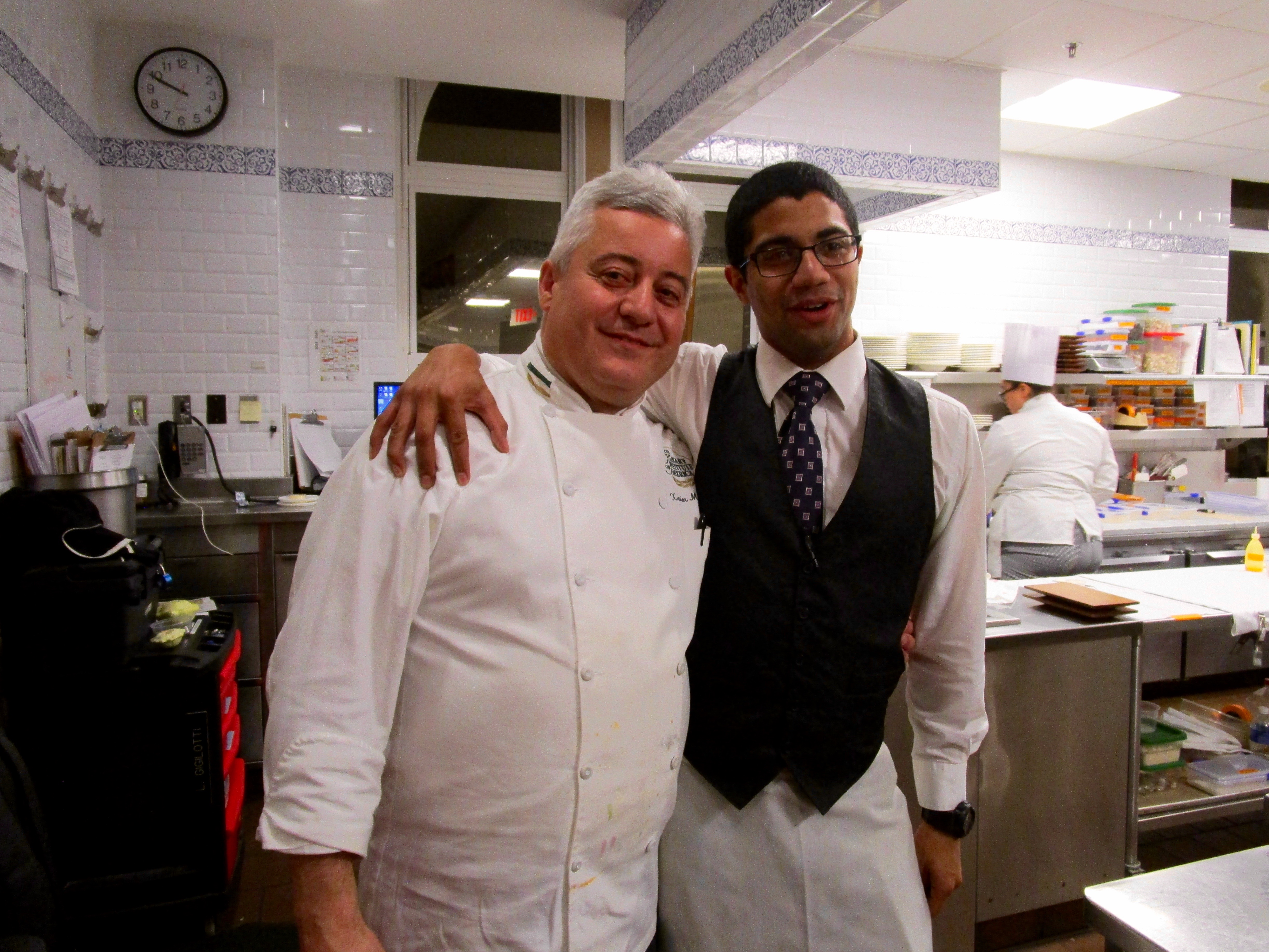 WE ALL WERE INVITED INTO THE KITCHEN FOR A TOUR (No, we didn't ask!).  THIS IS THE PROFESSOR CHEF AND OUR STUDENT WAITER.
