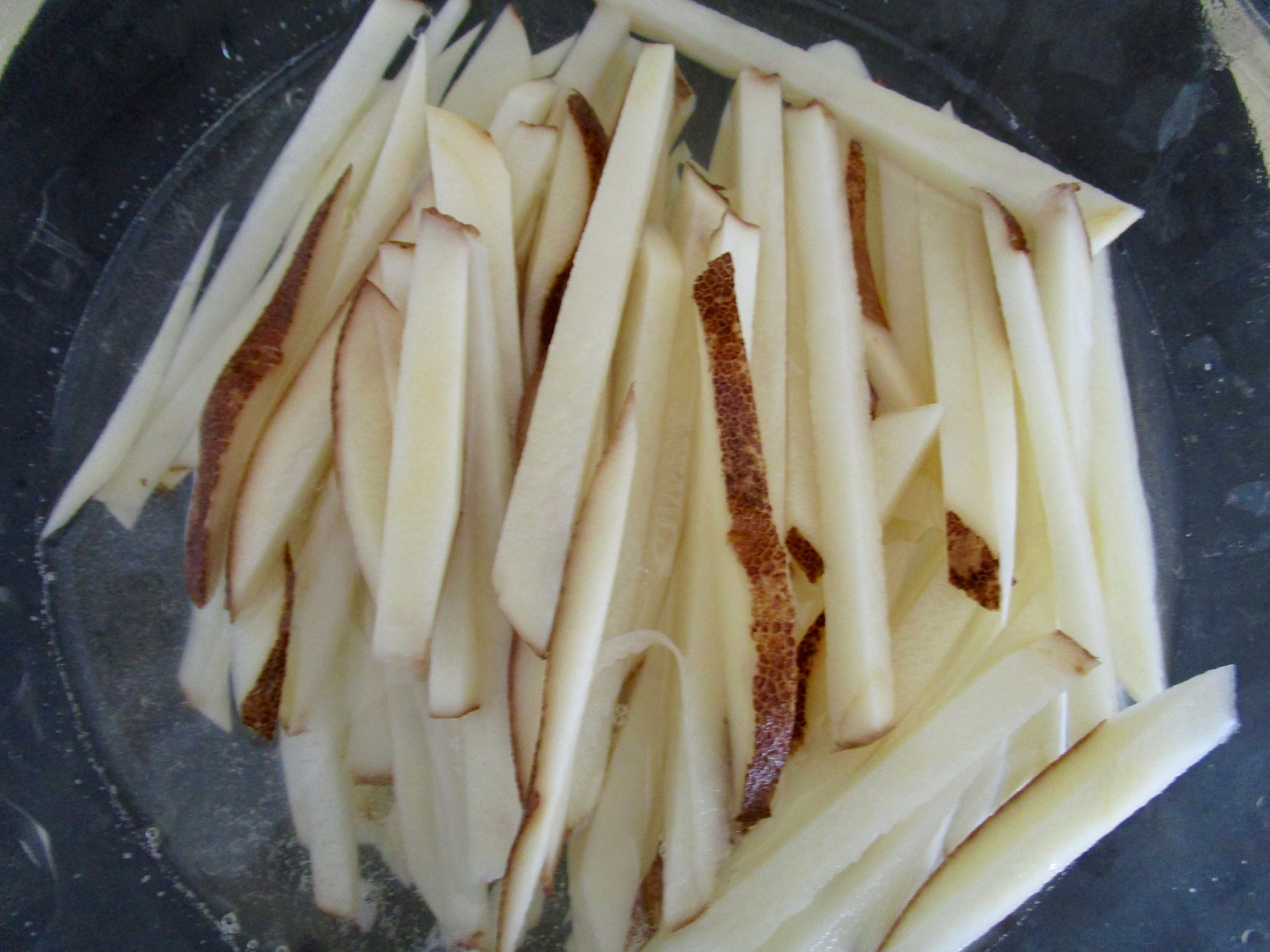 After cutting potatoes into 1/3 inch slices, cut each slice into  1/3-inch wide strips.