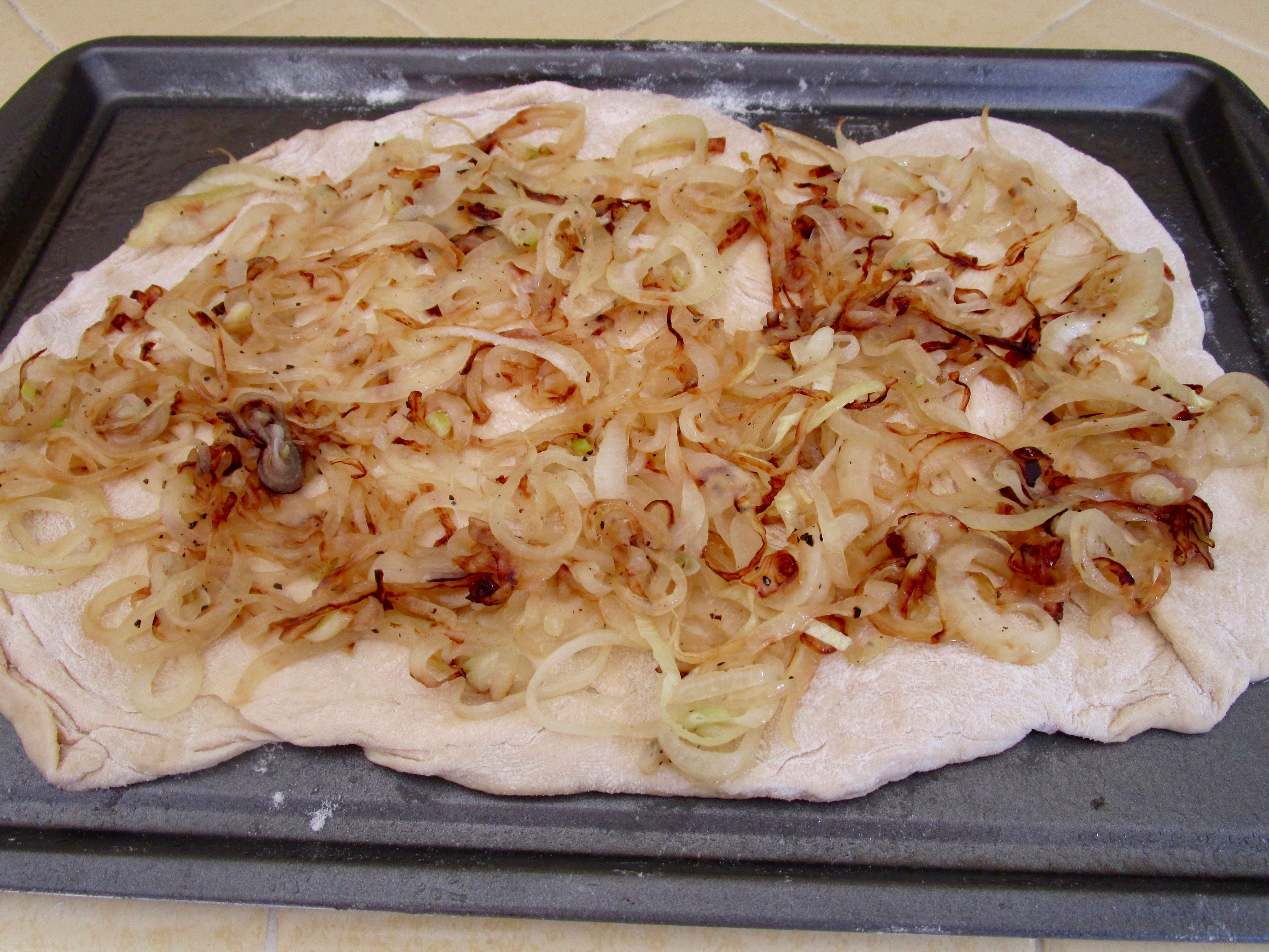 """The softened, caramelized  sliced onions are this pizza's """"sauce""""."""
