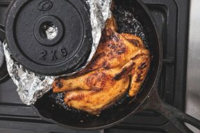 David used a leftover weight to weigh down his chicken while browning it on top of the stove.
