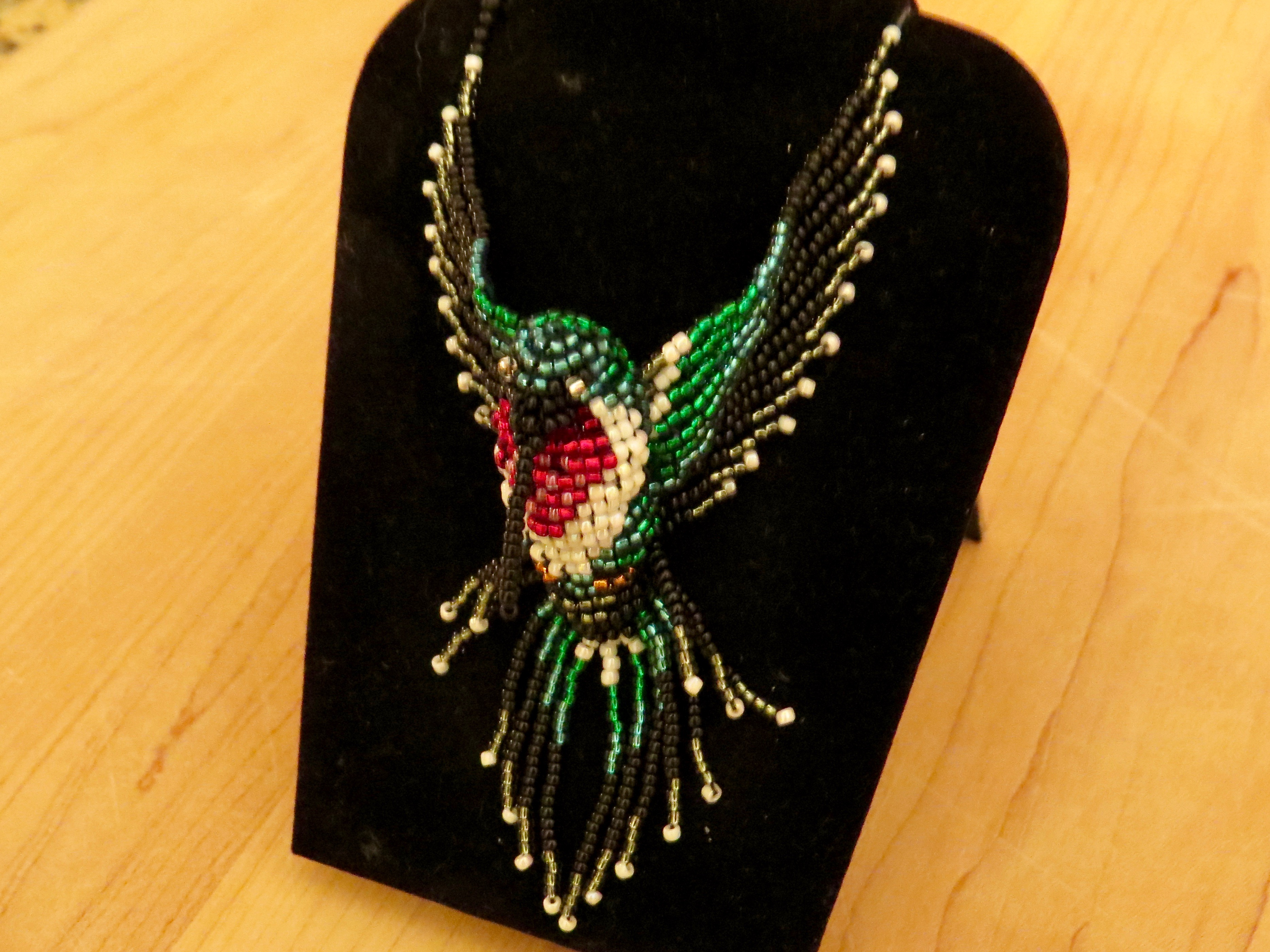 For my birthday Clara made me this exquisite Hummingbird Necklace which she designed and beaded herself. Her Mother found a perfect hummingbird picture and Clara translated it into jewelry. It is quite beautiful and I was, in a word, thrilled.