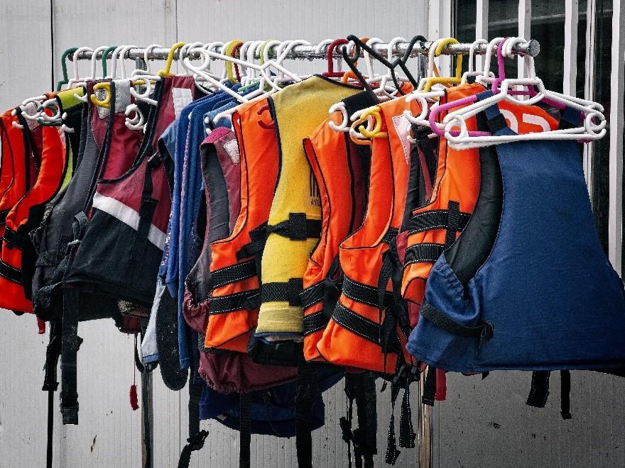 life jackets on rack