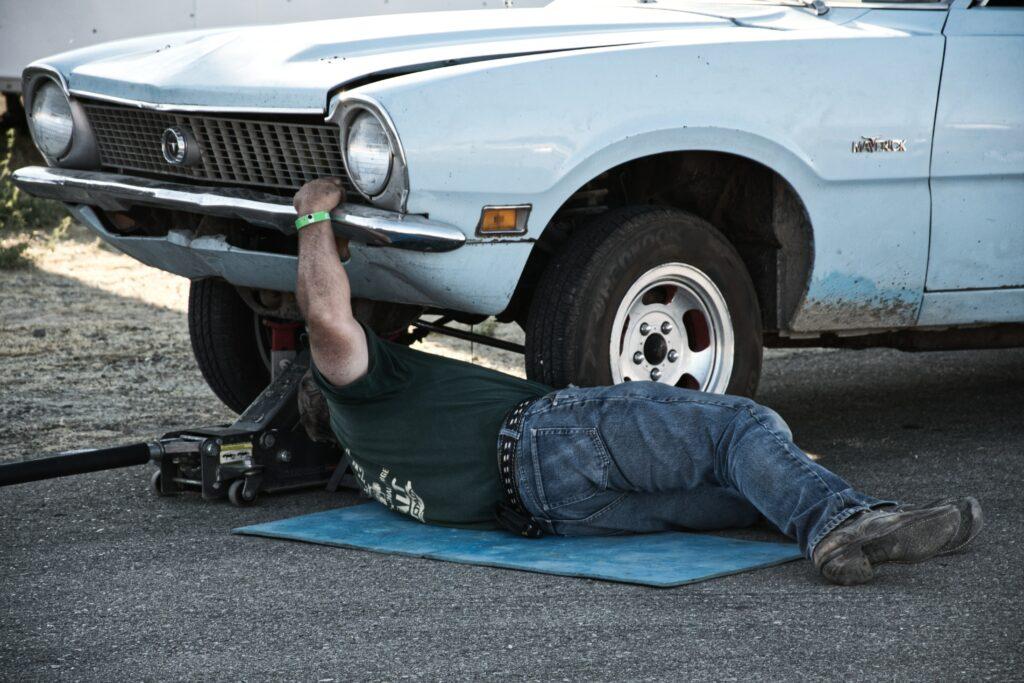 Man checking used car