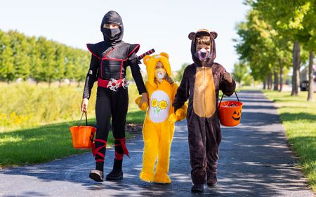 Hallowen Trick-or- Treaters wearing Covid masks
