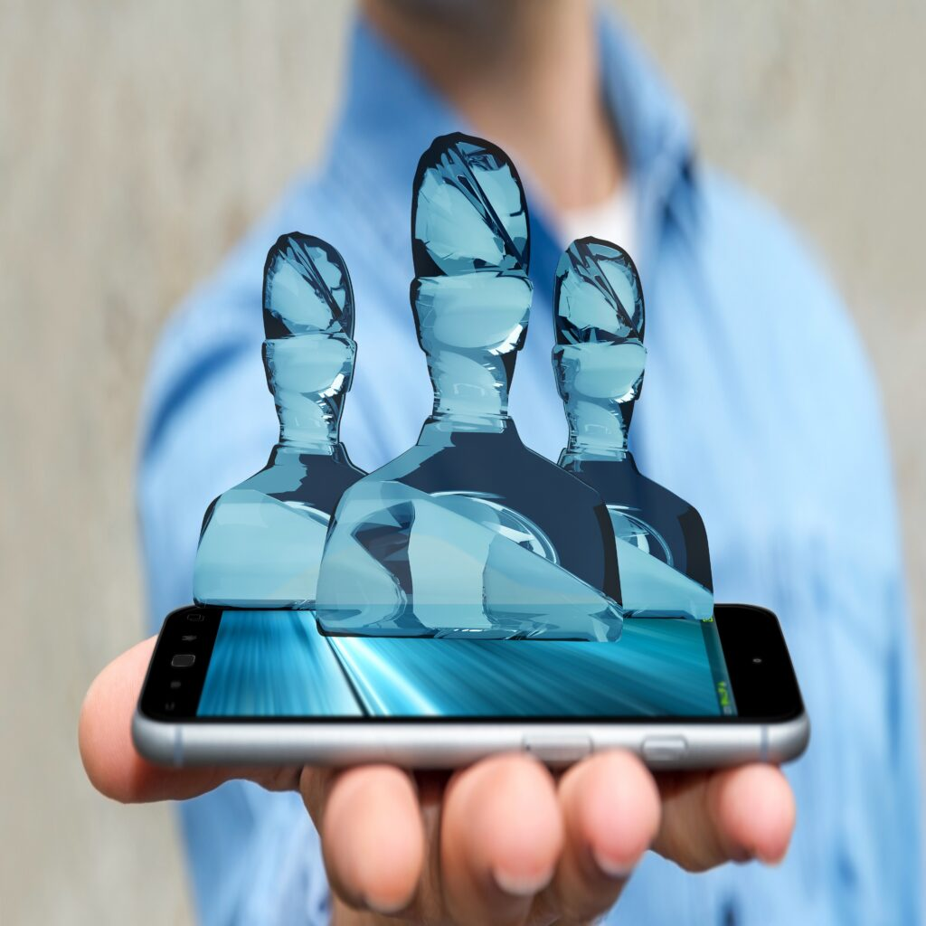 Businessman on blurred background with shiny glass avatar group over mobile phone 3D rendering