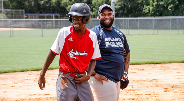 L.E.A.D. Ambassador and APD Detective at 4th Annual Safe at Home Game