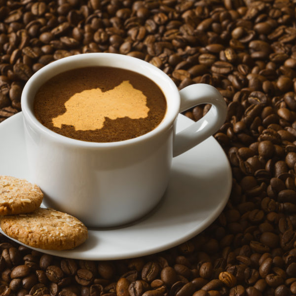 Coffee cup with Rwanda and biscuits
