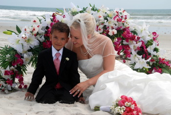 bride and son floral arch