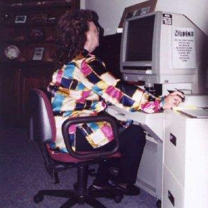 Volunteer Jean Cochran using Microfilm reader in research room at EVHS