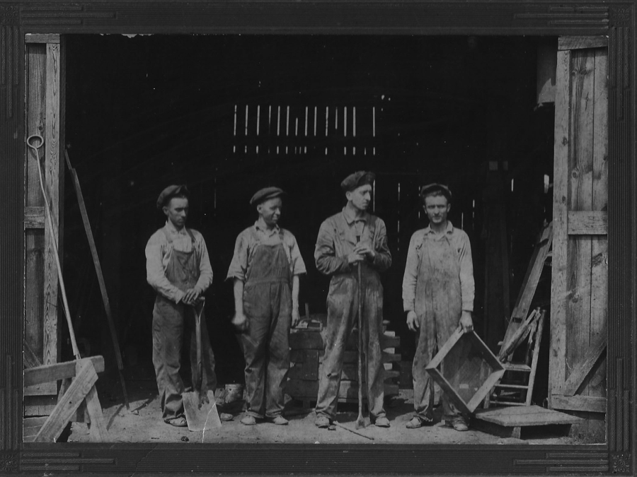 John Baker, second from left standing in main foundry door way. Circa early 1930's.