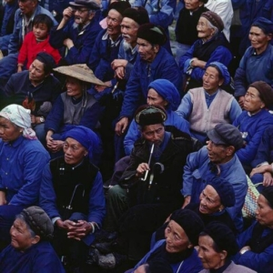 A CROWD of ethnic BAI PEOPLE watches a CHINESE OPERA PERFORMANCE in the farming town of DALI - YUNNAN, CHIN