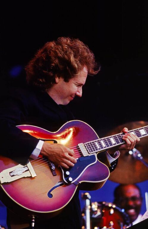 LEE RITENOUR plays GUITAR with FOURPLAY at the MONTEREY JAZZ FESTIVAL - CALIFORNIA