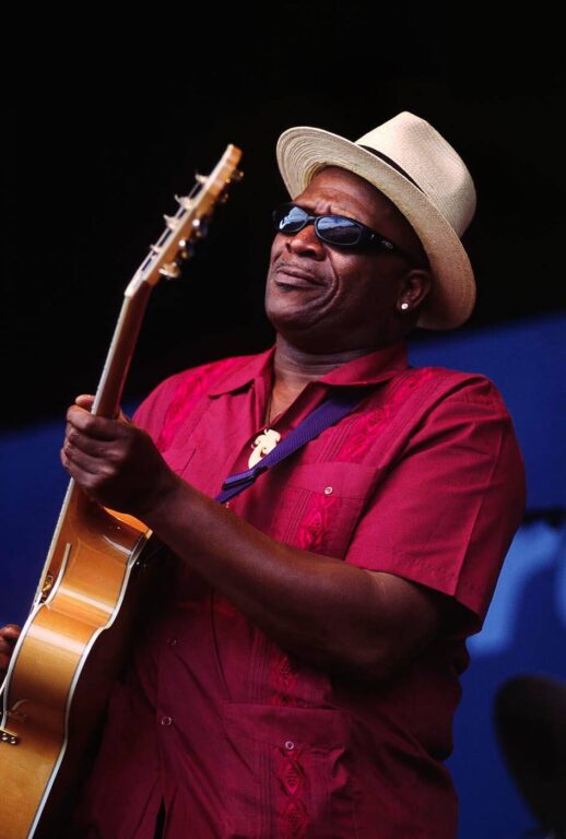TAJ MAHAL performs with an acoustic guitar at the MONTEREY JAZZ FESTIVAL - CALIFORNIA