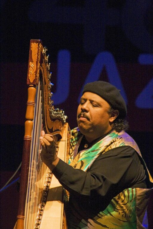 Carlos Reyes preforms on the harp  with John Handy and the 40th Anniversary Quintet at the MONTEREY JAZZ FESTIVAL