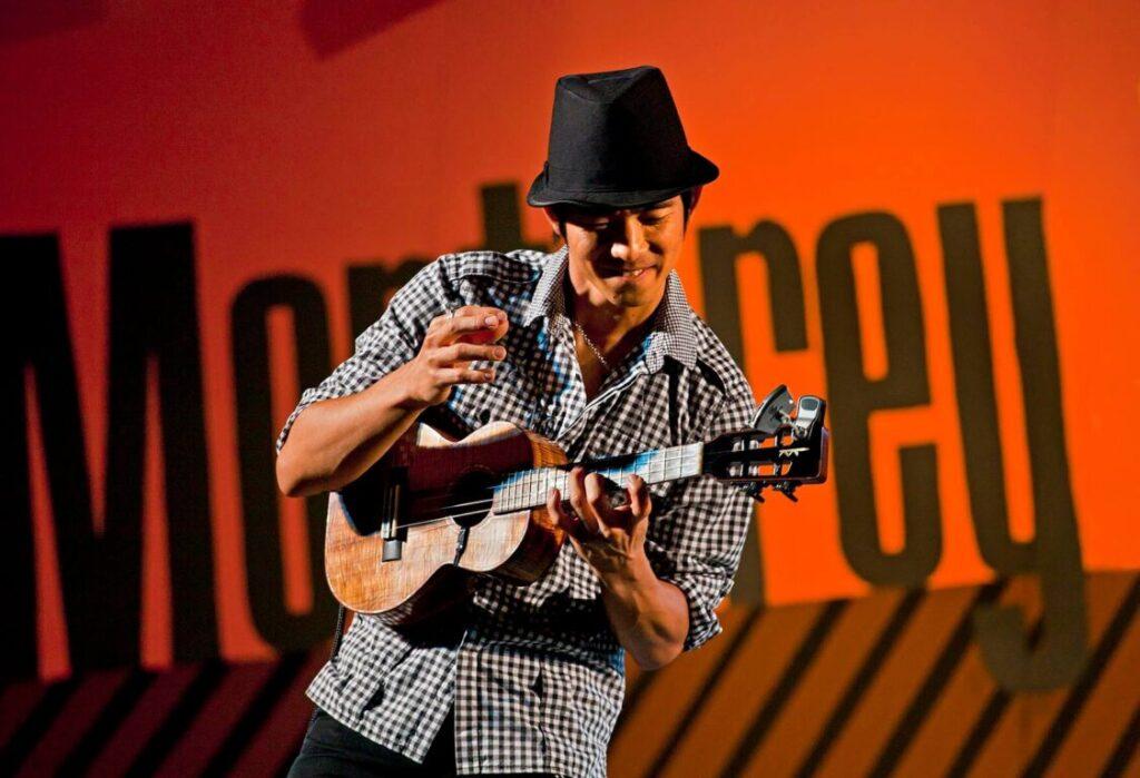 JAKE SHIMABUKURO plays guitar and sings on the Garden Stage - 2010 MONTEREY JAZZ FESTIVAL, CALIFORNIA