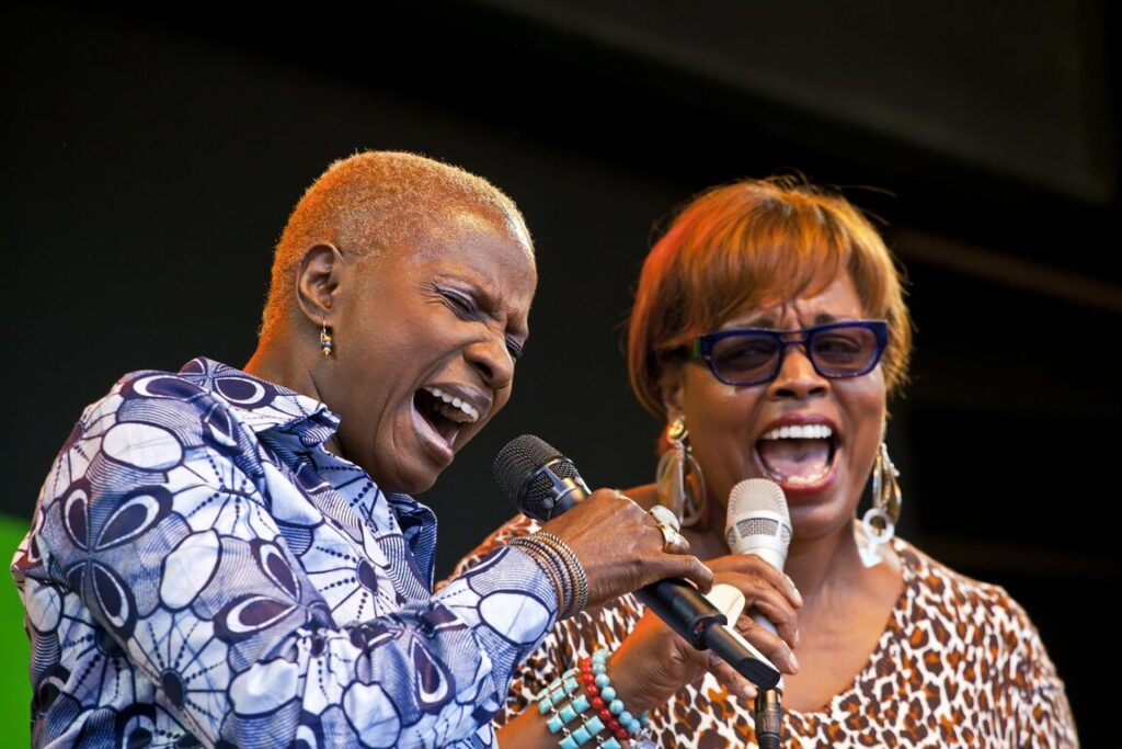 ANGELIQUE KIDJO sings a duet with DIANNE REEVES on the Jimmy Lyons Stage - 2010 MONTEREY JAZZ FESTIVAL, CALIFORNIA
