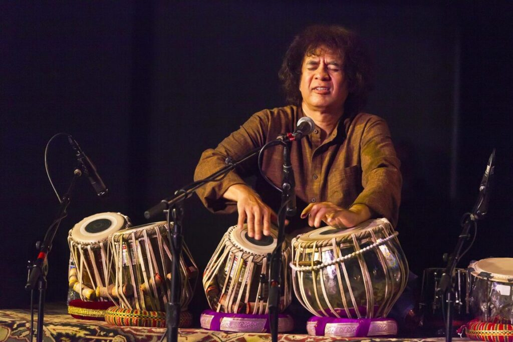 CHARLES LLOYD on saxophone, ZAKIR HUSSAIN on tablas and ERIC HARLAND on drums preform as SANGAM at the MONTEREY JAZZ FESTIVAL