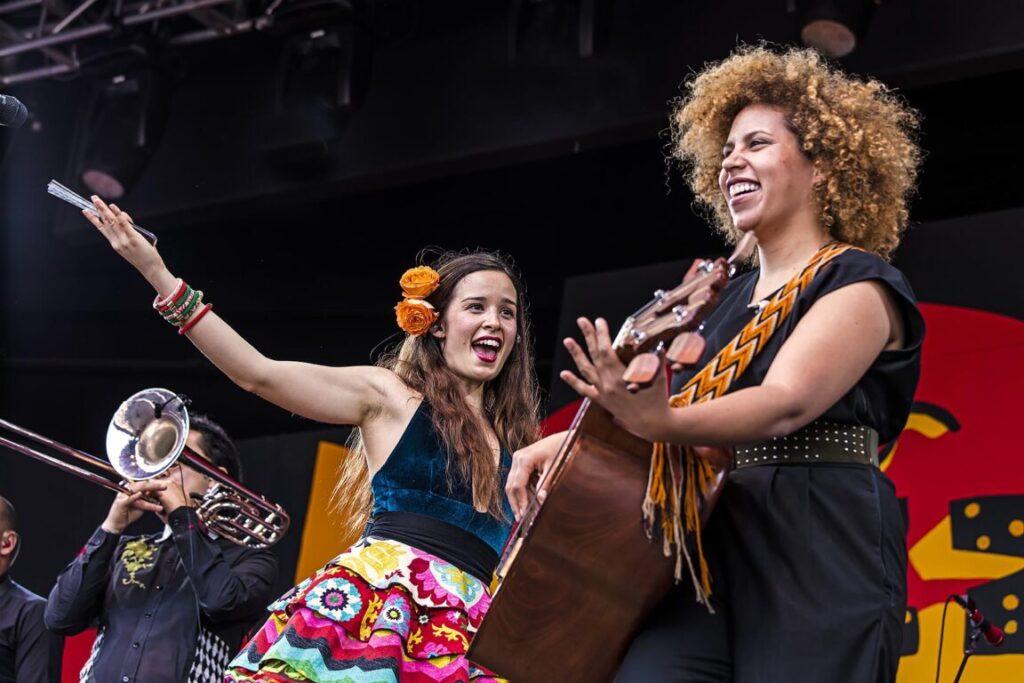 CATALINA GARCIA sings with ADINDA MEERTINS on base guitar with the Columbian band MONSIEUR PERINE - MONTEREY JAZZ FESTIVAL, CALIFORNIA
