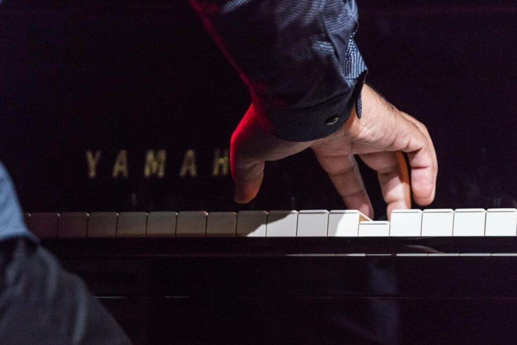 The hands of TERRY BREWER on piano with the BAYLOR PROJECT performing at the 61st Monterey Jazz Festival - MONTEREY, CALIFORNIA