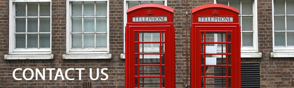 Two red telephone booths infront of a dark brown brick building. With Contact us written in white text in the lower left corner.