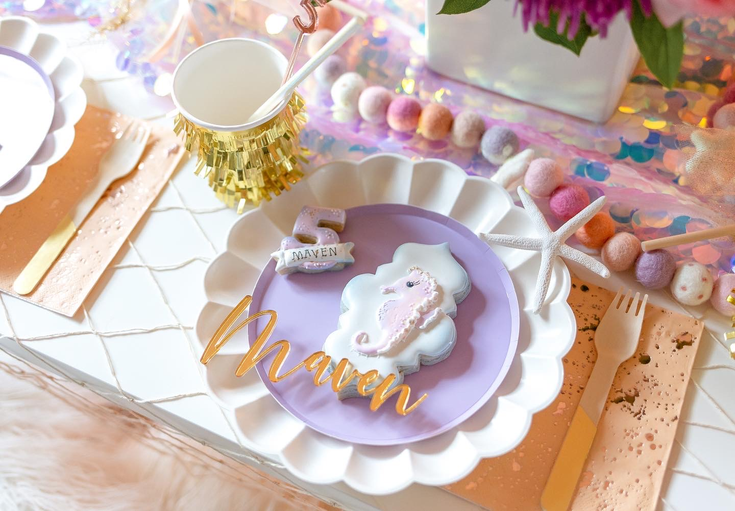 Seahorse cookie on purple plate for little girls 5th birthday