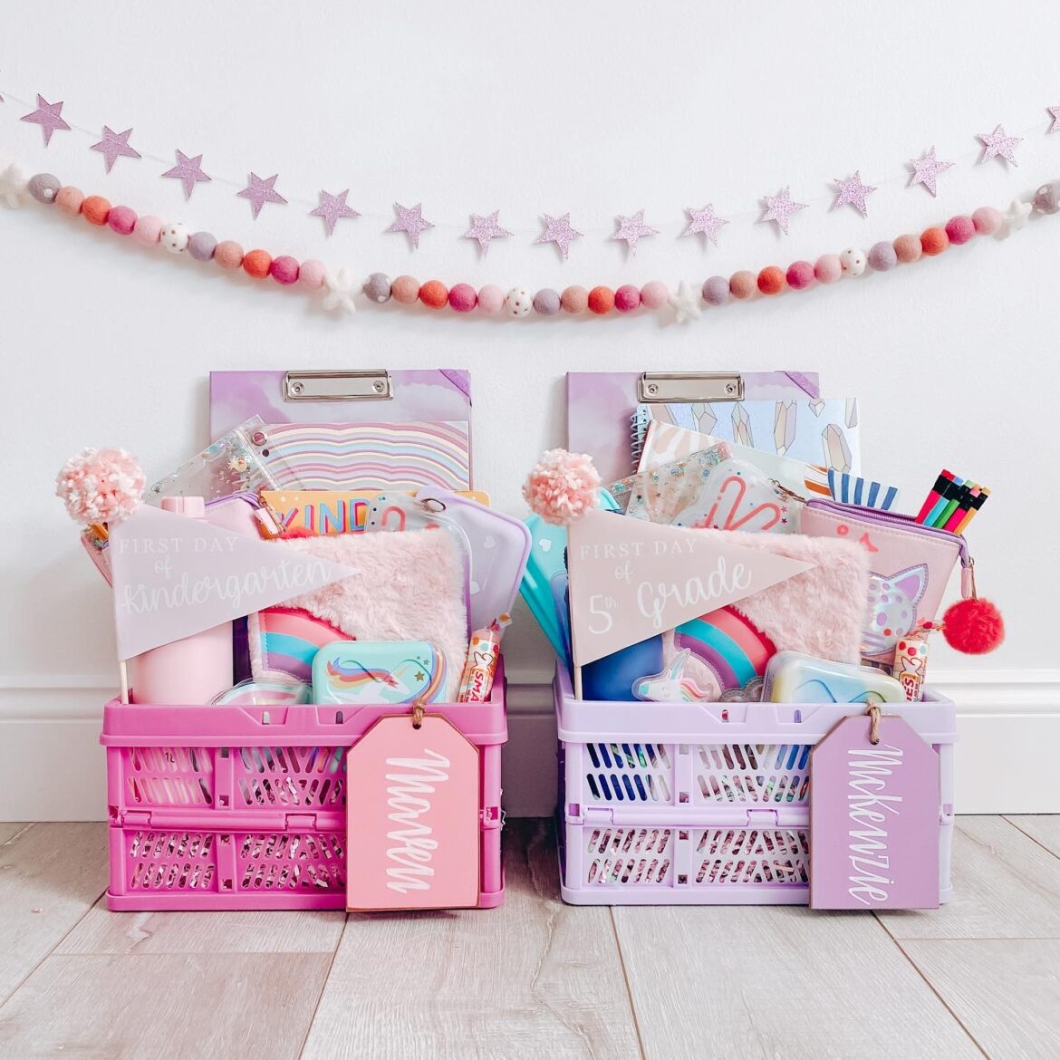 Pink and purple crates with school supplies in them