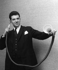 Man Using an Antique Hearing System with Horn and Tube