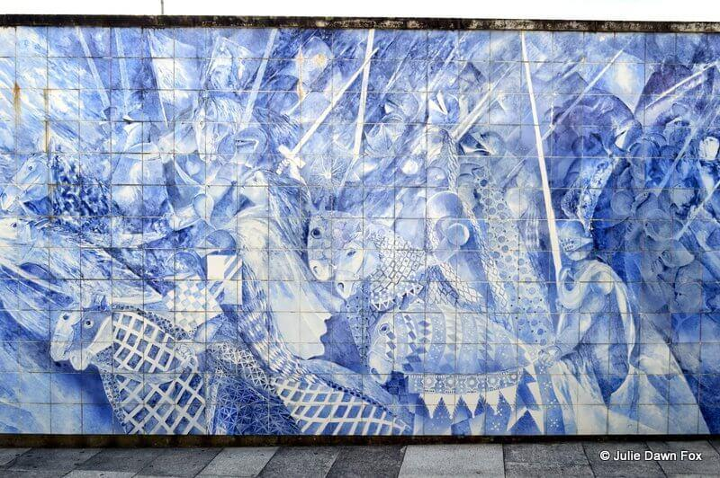 Hand painted tiled panel of horses and soldiers in battle