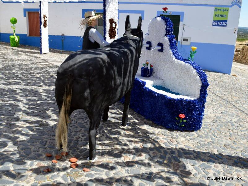 Paper donkey and water fountain