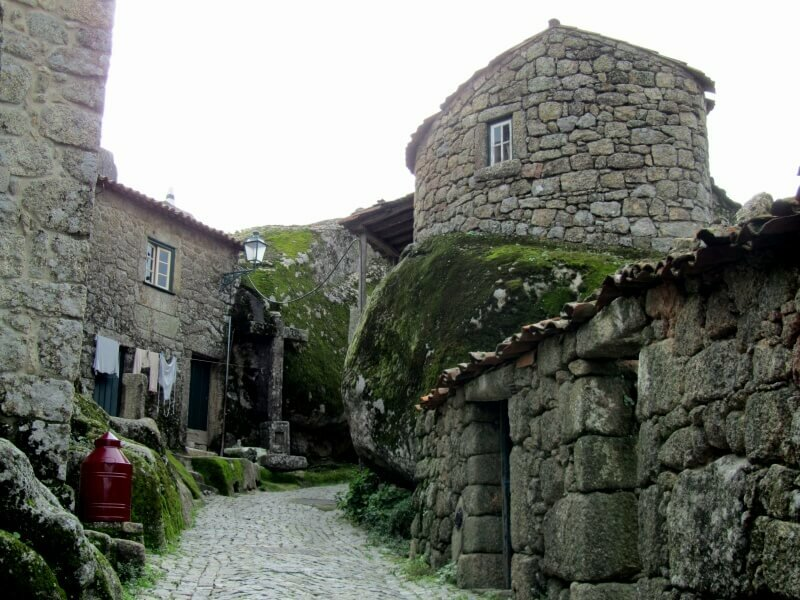 Monsanto village street with circular house on a boulder