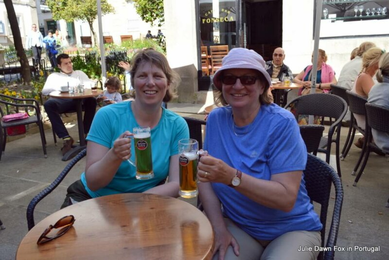 Dori and I with celebratory beers having reached Santiago de Compostela on the Portuguese Camino