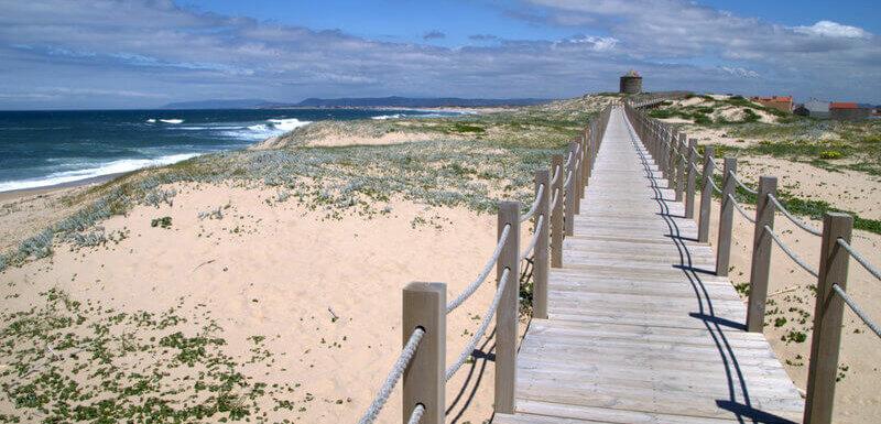 wooden-boardwalk-leadign-to-a-disused-windmill-near-agucadoura-coastal-portuguese-Camino