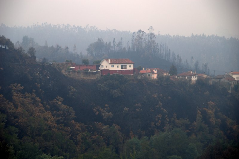 The aftermath of the October 2017 fires that spread across the hillside up to the houses