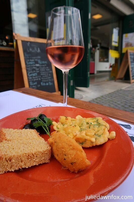 Cod snacks and rosé wine. Porto food tour
