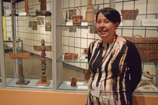 women in front of indegenous art exhibit