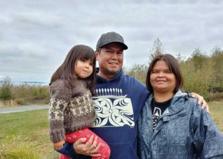 lessLIE with his daughter and partner
