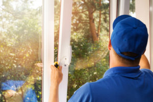 photo of a window contractor replacing a window