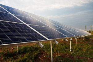 image of sun shining on solar panels