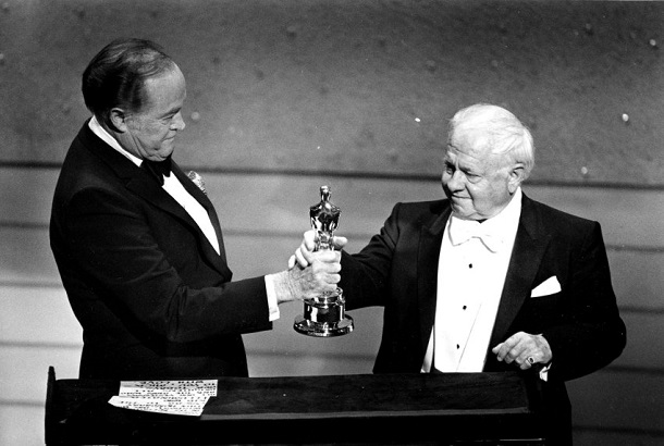 Entertainer Bob Hope, left, presents the Honorary Oscar for Lifetime Achievement to actor Mickey Rooney at the 55th Annual Academy Awards ceremony in Los Angeles, Ca., April 10, 1983.  Rooney is honored for his 60 years of contribution to the motion picture industry.  (AP Photo)