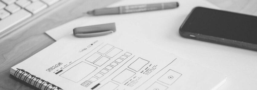 Website design wireframe on notebook paper