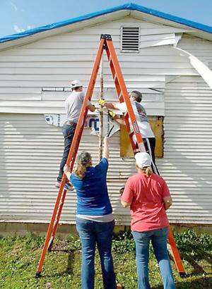 Leadership Miami Donates Time for Quapaw Tornado Victim