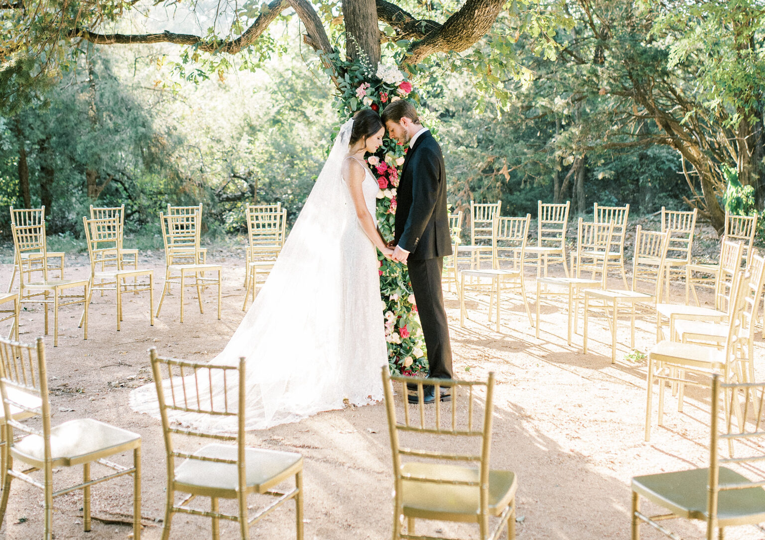 Bride and Groom in one of the outdoor ceremony sites (garden wedding) at Thistle Hill Estate in Whitesboro, TX.