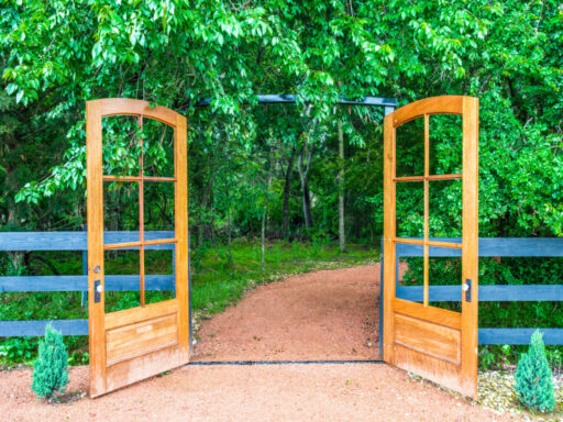 Gate doors to wooded area at Thistle Hill Estate