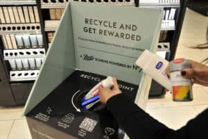 Products being dropped into the in-store recycling bin