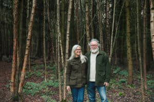 Founders Rose and Chris Bax, pictured in woodland setting