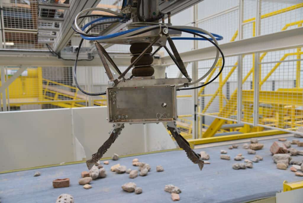 Shot of AI-powered robot recycling of C&D waste