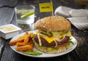 Heura burger on a plate with fries
