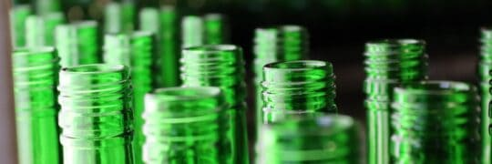 Close-up image of green glass bottles